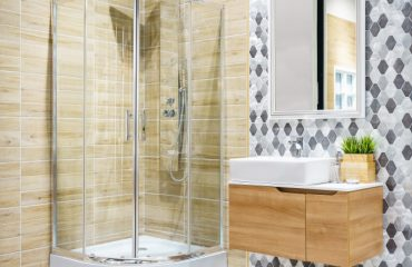 bathroom-interior-with-a-shower-cabin-with-glass-wall-a-toilet-and-faucet-sink_29285-401